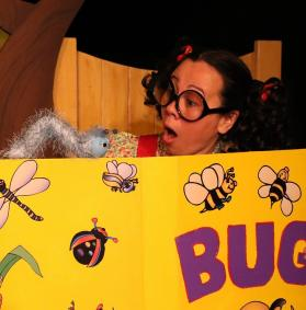 Trudy (actor) with Harold the Caterpillar (puppet) and the Bug Book, Photo Credit: Graham Gardner